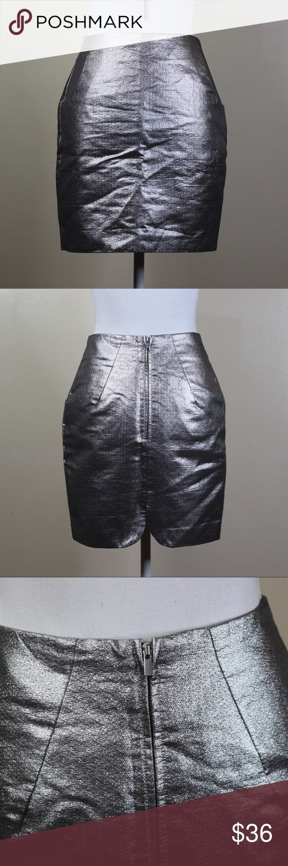 H&M Silver Mini Skirt Very cute mini skirt from H&M. Perfect condition. Ask me any questions you may have before buying. Materials listed in the pictures. H&M Skirts Mini