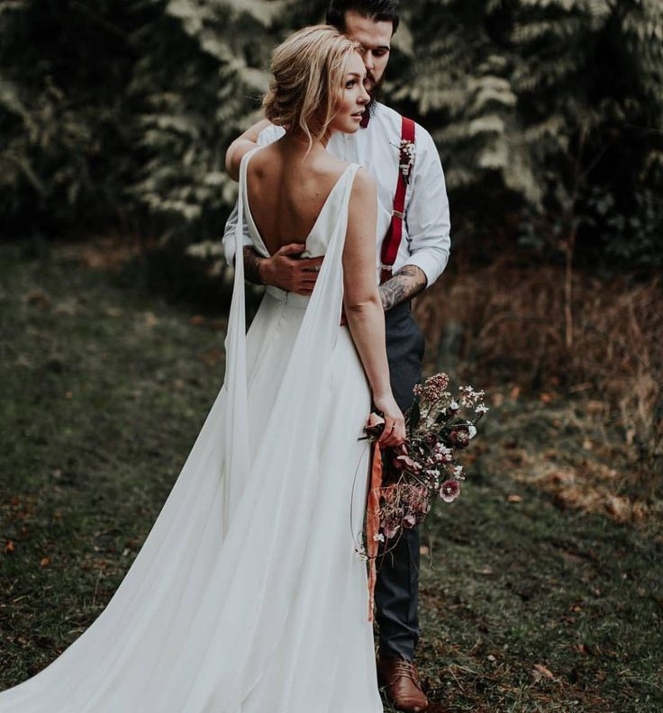 Bride wife husband bride woods outdoor wedding forest open back embrace hug love wedding photo photography