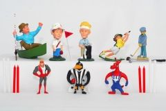 Sports figurines - including AFL players, cricket, fishing, golf and candles to match.