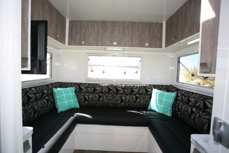 The Winnebago Burleigh has a rear club lounge that doubles as a dinette and converts to a bed. Wraparound windows and plenty of light and fresh air are great features.