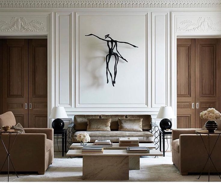 Today we have moldings on our mind as we work through the details of a few new construction projects. This Chicago home designed by Atelier AM has inspired us with its gorgeous plaster moldings and sky high ceiling! Artwork by Chris Ofili. #designinspiration #designerdiaries