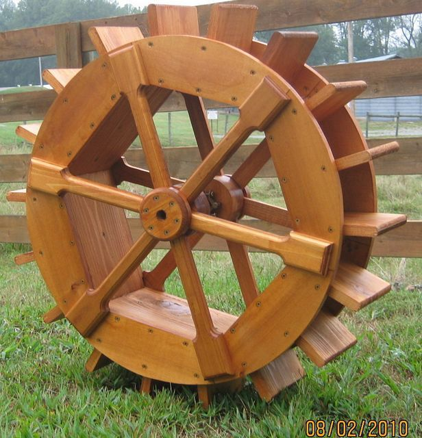 30 inch under shot wheel with flared spokes. Under shot wheels are designed to be pushed by the water flowing beneath them.
