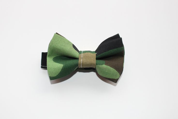 Camo Bowtie - brookzbabycompany   Let your little Beau's and Bella's express themselves with our one of a kind bow ties.  All Brookz bow ties are double layered and have a velcro neck strap so it can be worn by the tiniest of littles.  Recommended care instructions:  Spot clean only. Do not handwash or soak.  Hand made with love  www.brookz.co