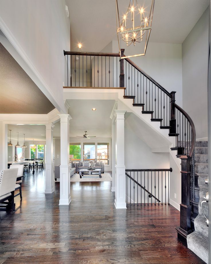 2 story entry way new home interior design open floor plan light fixtures spindles on - Home entrance stairs design ...