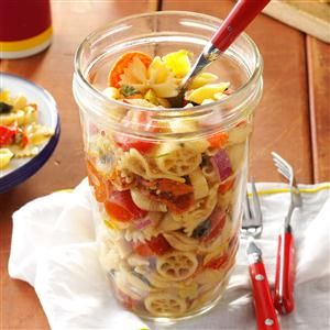 Pasta Salad in a Jar Recipe- Recipes  If you're planning a picnic, make this pasta a day ahead. For my husband's lunch at work, I sometimes tie a plastic fork on the jar. —Pat Neiheisel, Leetonia, OH