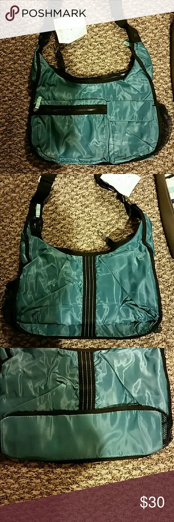 Thirty-one bag nwt Nwt Thirty-one bag. Perfect for the gym or a baby bag or even a purse. Easy to clean adjustable strap and pockets inside and out Thirty-one  Bags Crossbody Bags