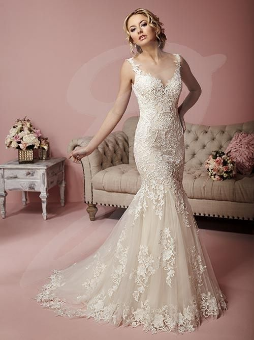 Balletts Bridal - 23407 - Wedding Gown by Jacquelin Bridals Canada - This dress is drenched in a thick, luscious net of popping laced and lace appliqués, making an impressive trumpet-style gown with illusion neckline and partial open back with satin-covered buttons over a zipper.