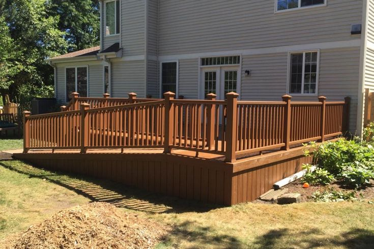 Trex® Tree House Deck with ADA Ramp Gurnee | Rock Solid Builders, Inc.