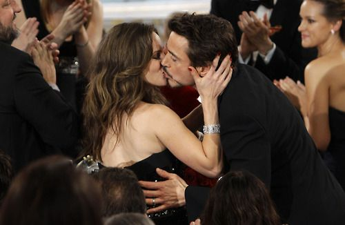 Robert and Susan Downey - OTP. It looks like she just landed one him unsuspectingly, which makes it all the better.