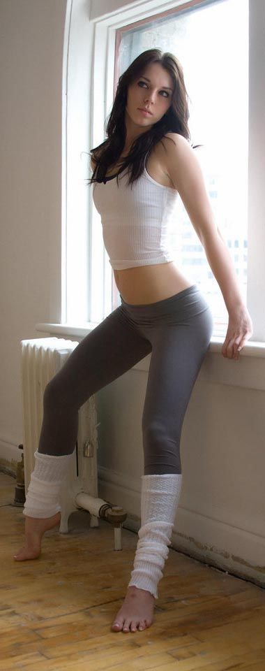 Something Hot girl in bright black yoga pants touching