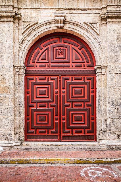 Red Door Side entrance door to the Iglesia de San Pedro Claver. Cartagena de Indias, Colombia.