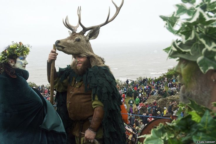 """Ms Hannant observed many of these customs have a distinct Pagan element. """"That is what fascinated me particularly,"""" the photographer said, """"the desire to connect to a potential Pagan past."""" These customs also often attract a huge turnout, such as the Jack-in-the-Green in Hastings in May (pictured), which attracts thousands of people and has a parade including giants, Morris dancers and fire-eaters. They lead Jack to the top of the castle hill, where he is ceremonially slain."""