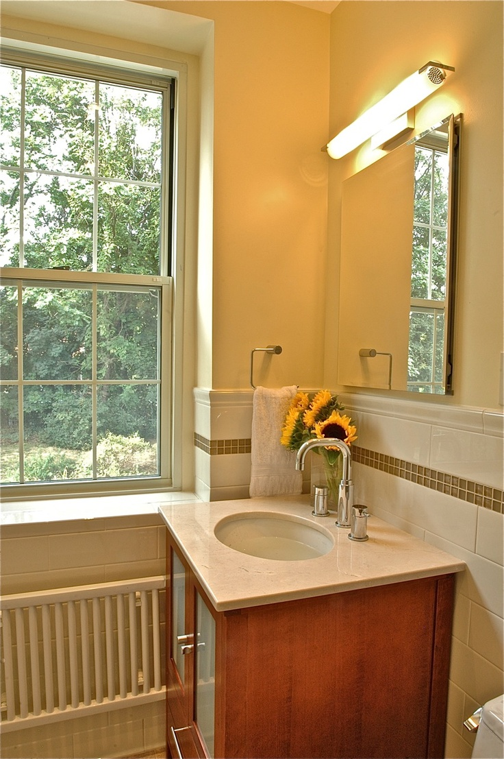 Soft Yellow Hue Bathroom With Off White Subway And Glass