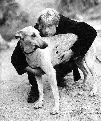 Brad Pitt with Blanco, his greyhound -- he found and adopted this stray greyhound while filming in the streets of Argentina.