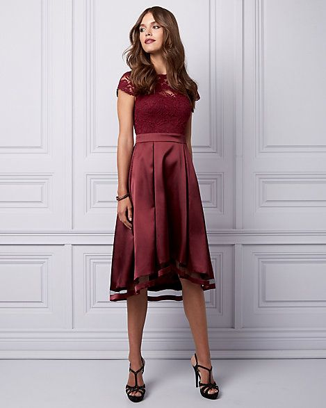 Lace & Satin Illusion Dress - R.S.V.P. to your next occasion in style with this lovely high-low dress styled with a romantic illusion neckline and a flattering fit-and-flare silhouette.