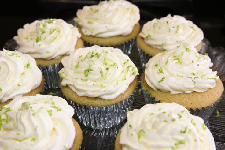 Dust frosting tequila cupcakes with lime shavings