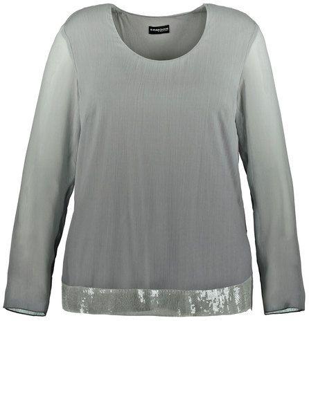 Met deze blouse heb je het juiste onderdeel voor speciale gelegenheden. Het model is gemaakt van vloeiende, kreukvrije kwaliteit en toont een glinster...
