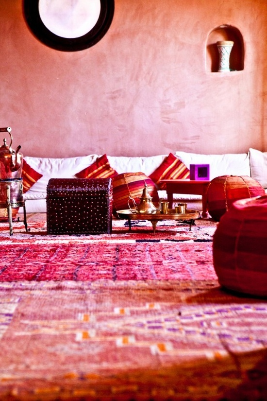 Check out Atlas Kasbah in Agadir Morocco. Love the hot colored carpets  tadelakt walls with the low Moroccan banquettes.