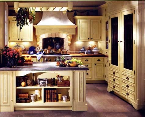 Image from www.didemhomes.com  Intricate moldings, hand-carved details and light woods are hallmarks of a French inspired kitchen. Ample accessories help to personalize the space.
