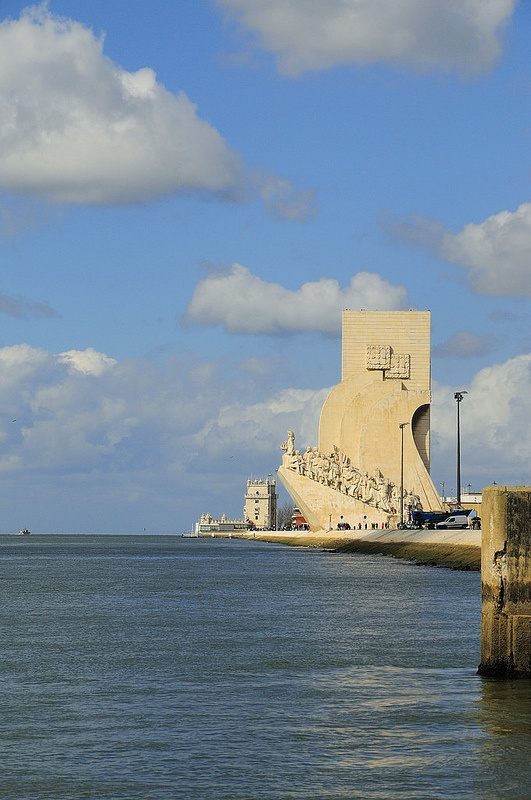View (to the West) of the Monument to the Discoveries and Belém Tower from the Belém Ferry Terminal, one of the locations of the film Night Train to Lisbon, being shot in Lisbon, Portugal. Photo: © Rui Rebelo via www.flickr.com/ruireb 05/April/2012