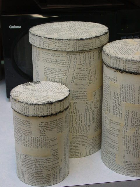 Boxes covered with old book pages,