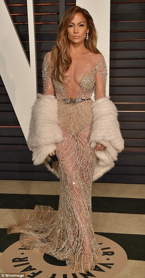 Jennifer Lopez wore a cleavage-exposing dress to the Oscar ceremony and then changed into this revealing gown at the Vanity Fair party. The sheer nude dress meant she wore neither bra or knickers for the evening