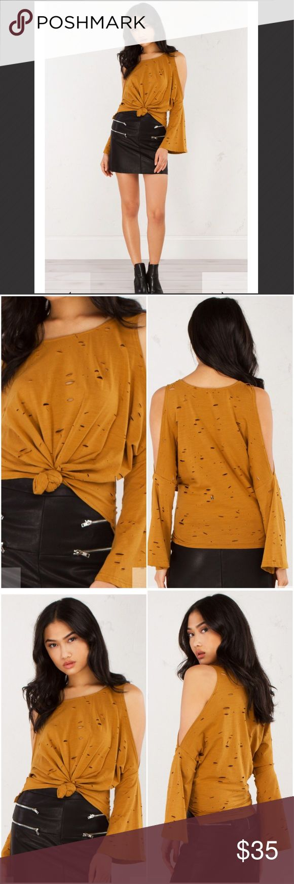 "🆕💋COLD SHOULDER TOP- Color Camel It should be illegal for a top to look this fab! Break the rules ladies, and clutch your paws onto the adorable Against The Rules Cold Shoulder Top. This exclusive piece is flooded with distressed cutouts and has exaggerated shoulder cutouts, flared long sleeves, a pull on construction and cropped front hem with knotted detail. Looking for a dynamite finishing touch? How about a sexy, black leather mini.  - 95% Cotton, 5% Spandex - 24"" from shoulder - Hand…"