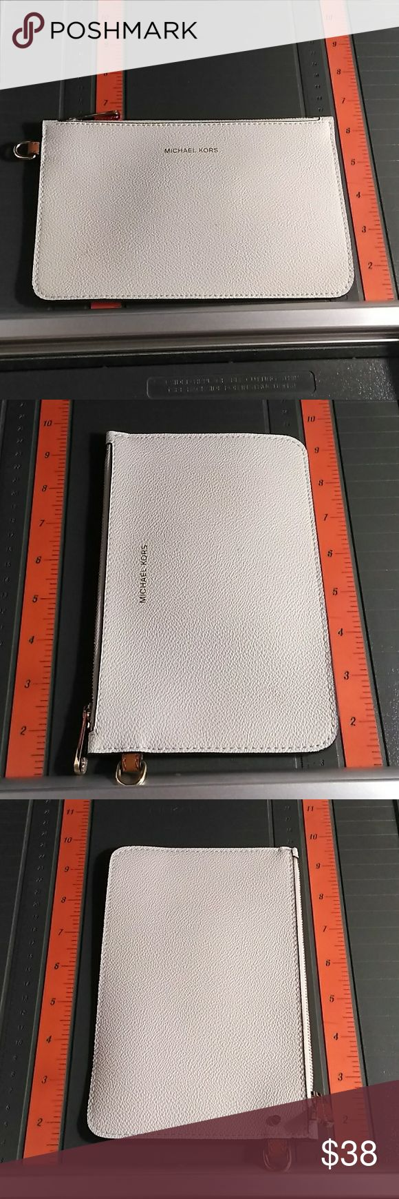 Michael Kors pouch This Ivory White pouch will go well with organizing your receipts coupons makeup or even just put your cell phone in it so it does not get scratched in your purse 😉 Michael Kors Bags Travel Bags