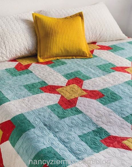 Cabin Fever Quilts as seen on the TV Show Sewing With Nancy on PBS with Nancy Zieman and Guest Natalia Bonner. Featuring the book, Cabin Fever Quilts - 20 Modern Log Cabin Quilts.