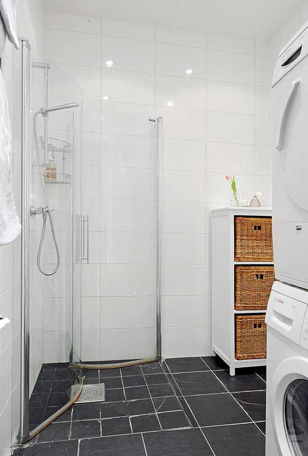 Wow...shower doors that swing in and out...what a great way to open up space when the shower is not in use!    Cozy-Apartment-in-Sweden-(22)