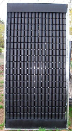 Pop can solar heat collectors.... I built one of these for a science project many decades ago in fifth grade...it was not as nice looking as this one though.