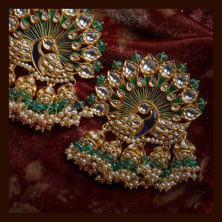 Peacock studs from the Sabyasachi Jewelry collection. Made in 22k gold, uncut diamonds, Zambian emeralds and heritage enamelling. For all jewellery related queries, kindly contact sabyasachijewelry@sabyasachi.com #Sabyasachi #SabyasachiJewelry #TheWorldOfSabyasachi