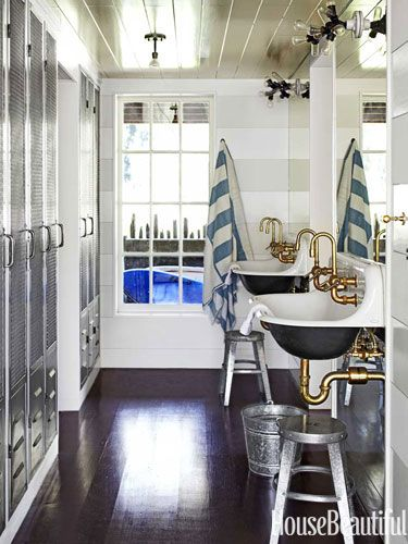 The bunk room bath is fitted with lockers for guests and family members.
