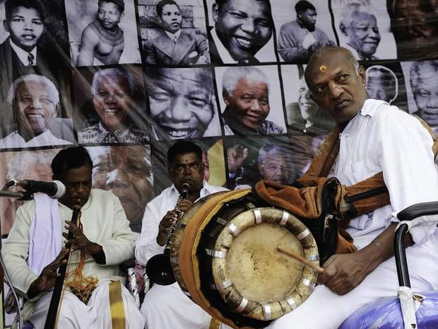 Indian local musicians play during birthday celebrations for Nelson Mandela - The Independent