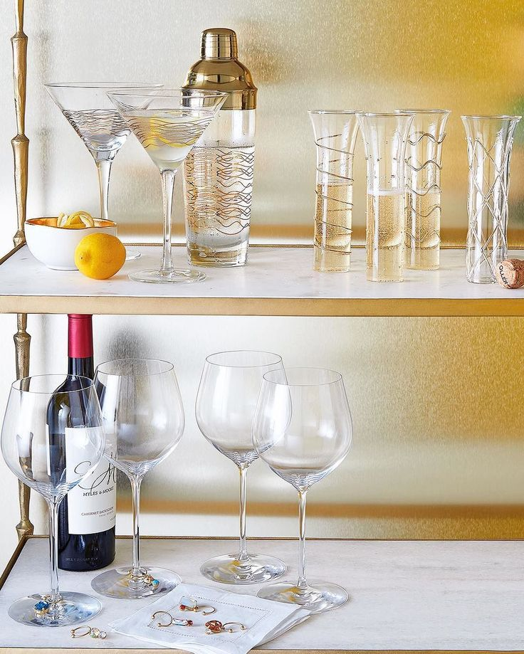 "#ONLYATNM Only Here. Only Ours. Exclusively for You. Handcrafted martini set. Soda glass and stainless steel. Set includes two martini glasses and one shaker. Martini glasses, 6""Dia. x 7""T; hold 8 ounces. Shaker, 3""Dia. x 10""T; holds 20 ounces. Hand wash. Imported. #ONLYATNM Only Here. Only Ours. Exclusively for You. Flutes made of clear glass. Embellished with metallic gold-tone designs. Set of four includes one of each design shown. Each measures approximately 2""Dia. x 7""T and holds 6…"