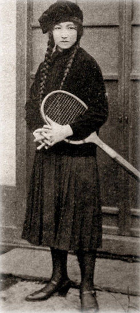 Japanese girl in pigtails with tennis racquet. 1928