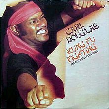"""Kung Fu Fighting"" is a disco song written and performed by Carl Douglas and composed and produced by Biddu.[1] It was released as a single in 1974, at the cusp of a chopsocky film craze, and eventually rose to the top of the British and American charts, in addition to reaching number one on the Soul Singles chart."