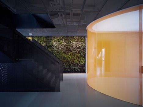 Green wall to enliven a dull space? Im liking the citrus wall too as a contrast! Taoyuanju Office by Vector Architects.