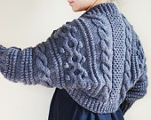 This Aran shrug comes in many colours, including ivory. Would look awesome over a wedding dress for a fall/winter wedding.