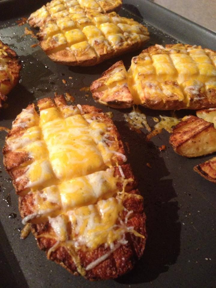 Roasted Baked Potatoes Split Potato In Half Slice Partially Through From Flat Side To Skin In