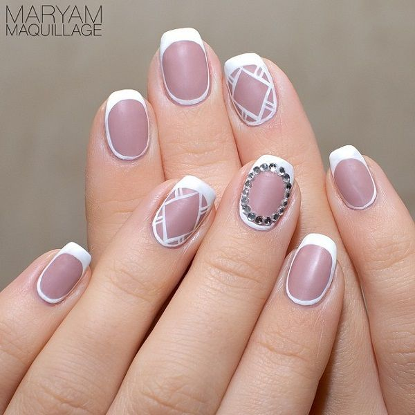 Gray and white nail art - White and pinkish gray French tips. Give your nails a different style of French tips by painting over the sides of the nails extending from the French tips.