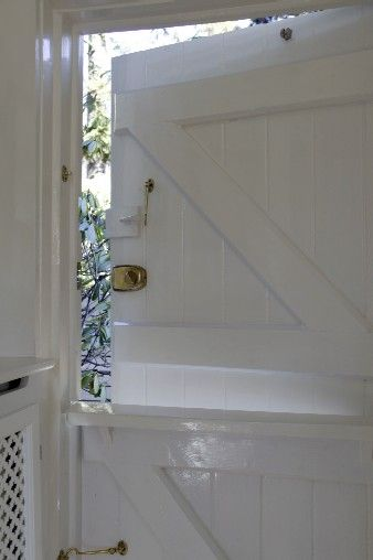 Here it is. The dutch door I want for my potting shed. Only I want some pretty painted decorations on on it.