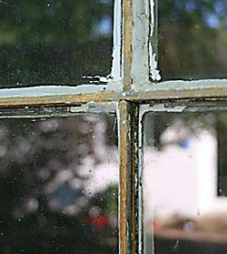 Window where the old glazing compound has been partially scraped away.