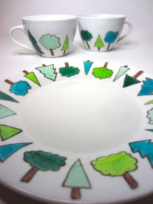 Plate and tea cups decorated using porcelain pens