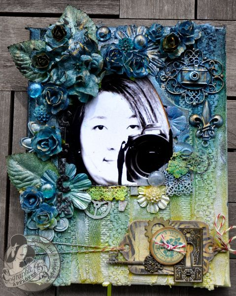 This is a mixed media canvas today by @Susan Lui using Graphic 45 staples and Tropical Travelogue Die Cut Chipboard. Love her Tattered Angels Glimmer Mists techniques! #graphic45 #mixedmedia