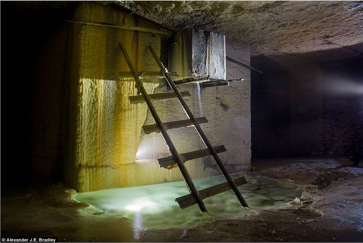 In order to reach the pools, visitors must descend through one of the ground entrances and trudge through murky water