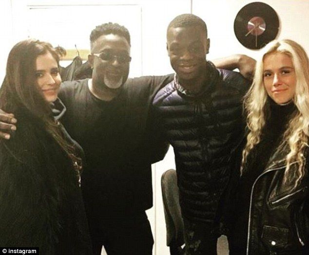 Cheryl pictured withBRIT nominated star J Hus  Cheryl has been notably absent from the charts for the last four years.  Yet after promising a comeback to the music scene the 34-year-old songstress seems to be wasting no time getting back into the recording studio as she was pictured inside one for the second time this week.  The former Girls Aloud star was seen posing with BRIT nominated star J Hus in a fan account on Saturday.  Scroll down for video  Making music: Cheryl featured in a photo…