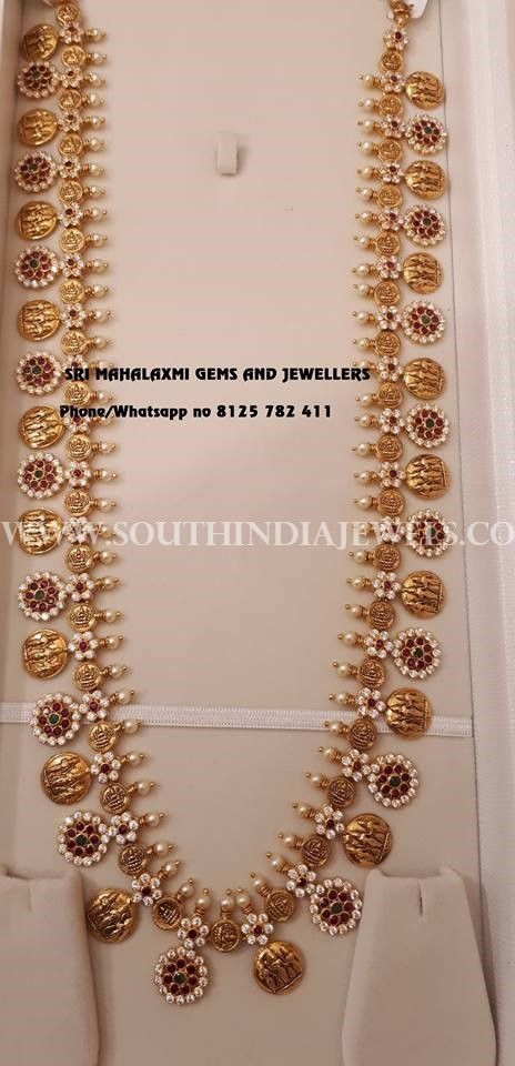 22k gold long Ram Parivar haram. For inquiries please contact the seller below. Seller Name : Sri Mahalaxmi Jewellers And Pearls Email: srimahalaxmijewellerandpearls@gmail.com Contact No : 9100592011 Facebook : https://www.facebook.com/srimahalaxmijewellerandpearl Related PostsGold Plated Long Lakshmi Necklace with JhumkaLong Ruby Emerald Haram With EarringsGold Long Haram with Floral PendantGold Antique Temple Ball Haram DesignTraditional Gold Haram …