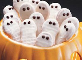 Nutter Butters dipped in white chocolate for Halloween ghost cookies PeanutButter