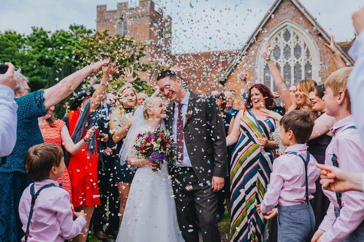 One word - CONFETTI! Photo by Benjamin Stuart Photography #weddingphotography #confetti #groupshot #justmarried #brideandgroom #weddingday